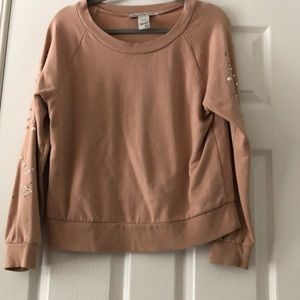 A Tan embellished sweater
